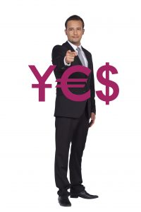 Businessman points money